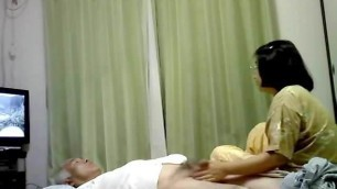 Old asian couple playing